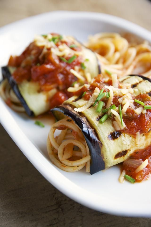 Grilled eggplant slices wrapped around spaghetti in a tomato sauce.: Eggplant and Spaghetti Involtini