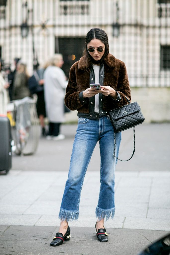 Frayed jeans, a fur coat, and a Chanel bag.