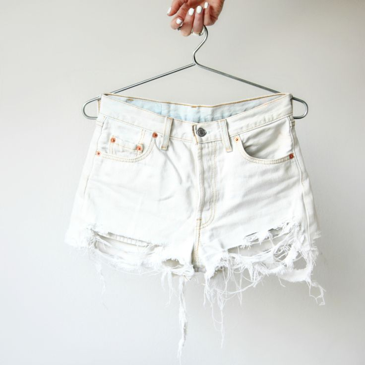 """""""After being dipped in a bucket of bleach and getting a ripping treatment, my Levi's 501 made their third transformation. From full lenth jeans into shorts into this white, trashy, destroyed piece. It'll only become more beautiful after a couple of washes which will make the strings, rips and tears look a bit more natural. I used the same technique to destroy the denim as in this post."""""""