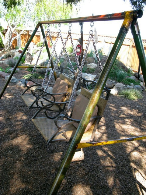 a vintage swing frame with wicker swing chairs...so coooollllll