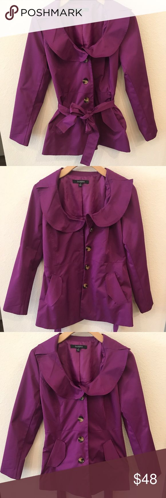 Purple Trench by Sandro Stidio NWOT purple trench coat, bought it and loved it but never found the occasion to wear it. It is waterproof but doesn't have a hood- it's really cute though! Sandro Jackets & Coats Trench Coats