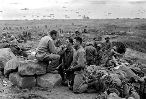 Soldiers receiving the Eucharist.