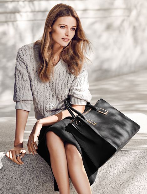 Black handbag in embossed faux leather, with detachable shoulder straps and inner compartments. | H&M Accessories