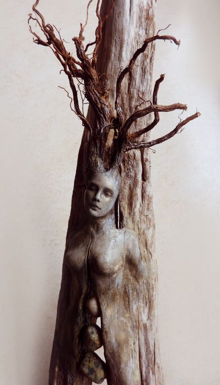 Love this. We have a bit of wood sculpted with the face of an old man and it's one of my favourite pieces in the house. Spirit Tree Woman with Stones by ShapingSpirit