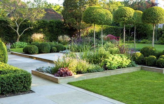 Good example of effectiveness of even a small change in elevation and attention to open and planted spaces, straight lines and rounded shapes.