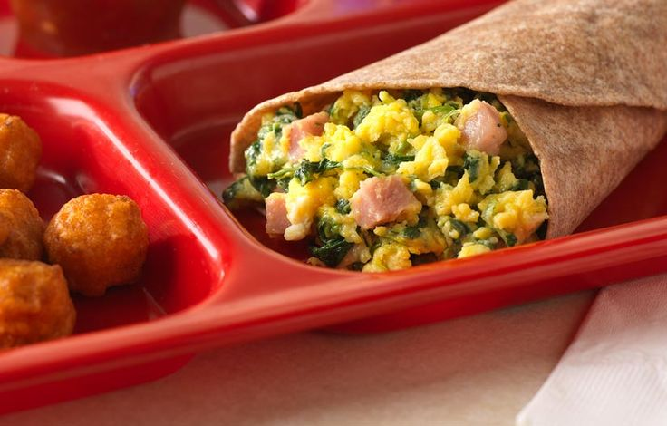 Green Eggs and Ham Brunch-for-Lunch: Dr. Seuss is popular any day! Scrambled eggs with spinach, turkey ham and cheese are served with a whole-grain flatbread.