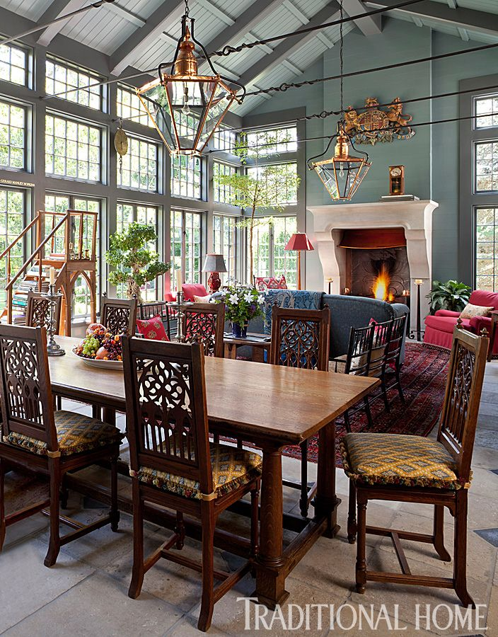 In the light-filled conservatory, a casual dining spot backs up to a cozy seating area. - Photo: Emily Minton Redfield / Design: Rochelle Warner