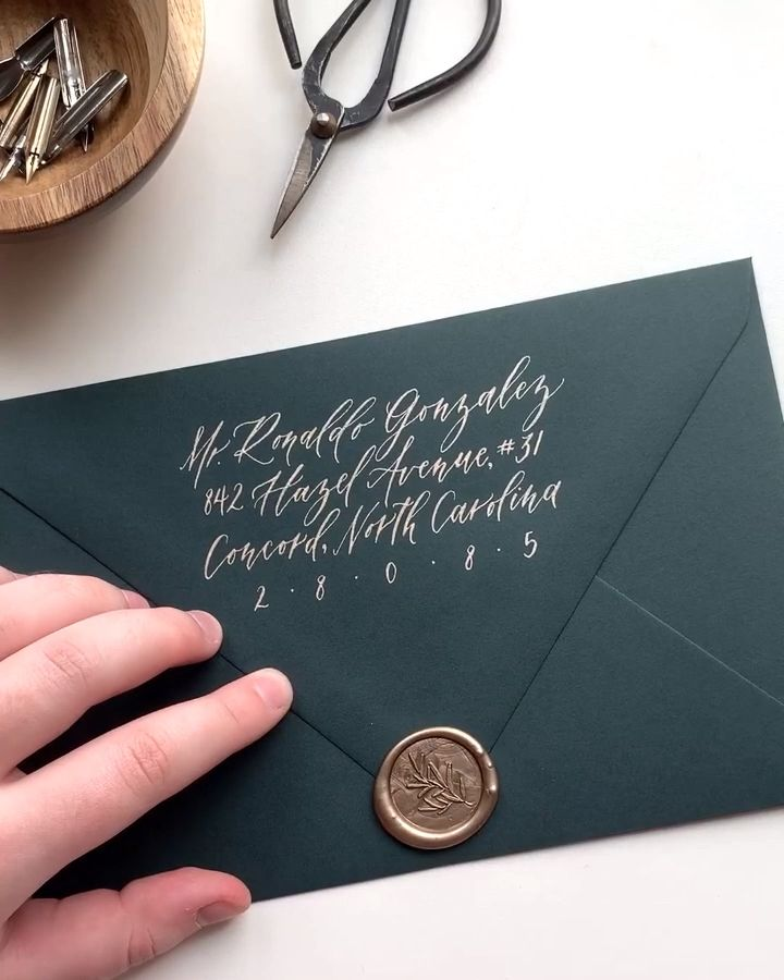 Elegant wax seals on custom, fine art, luxury wedding invitations