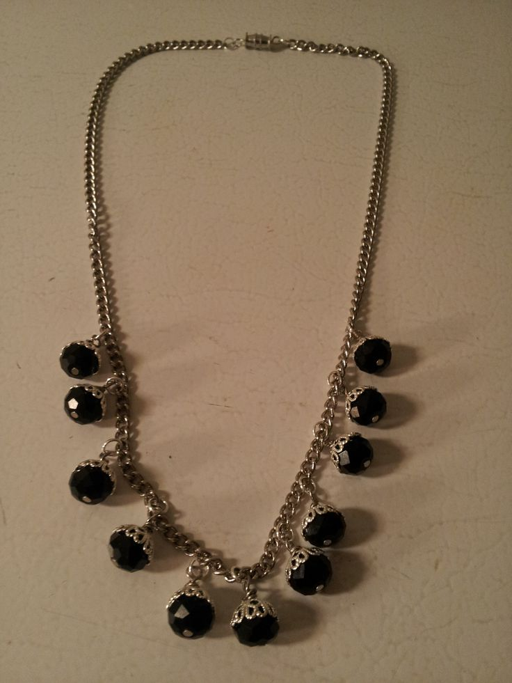 A Black Swarovski crystal chain and wire work necklace.
