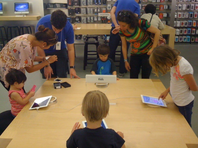 Kids in the Apple store well looked after.