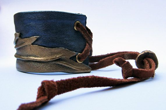 Leather bracelet with autumn leaf by artispartem on Etsy, $27.00