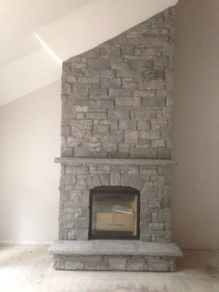 Muskoka granite large rock dry stack. Complete with stone hearth and mantel  Done by  Saunders Stone Design