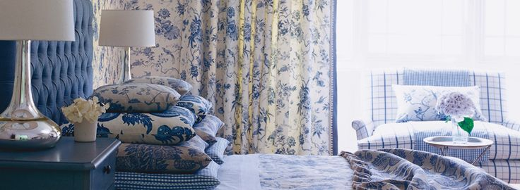 Bedroom with blue and white fabrics from Sanderson's Pemberley collection
