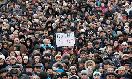 Ukrainians hold a placard reading 'Putin Stop', as they attend a rally on the Independence Square in Kiev on Sunday. Photograph: Sergey Dolzhenko/EPA