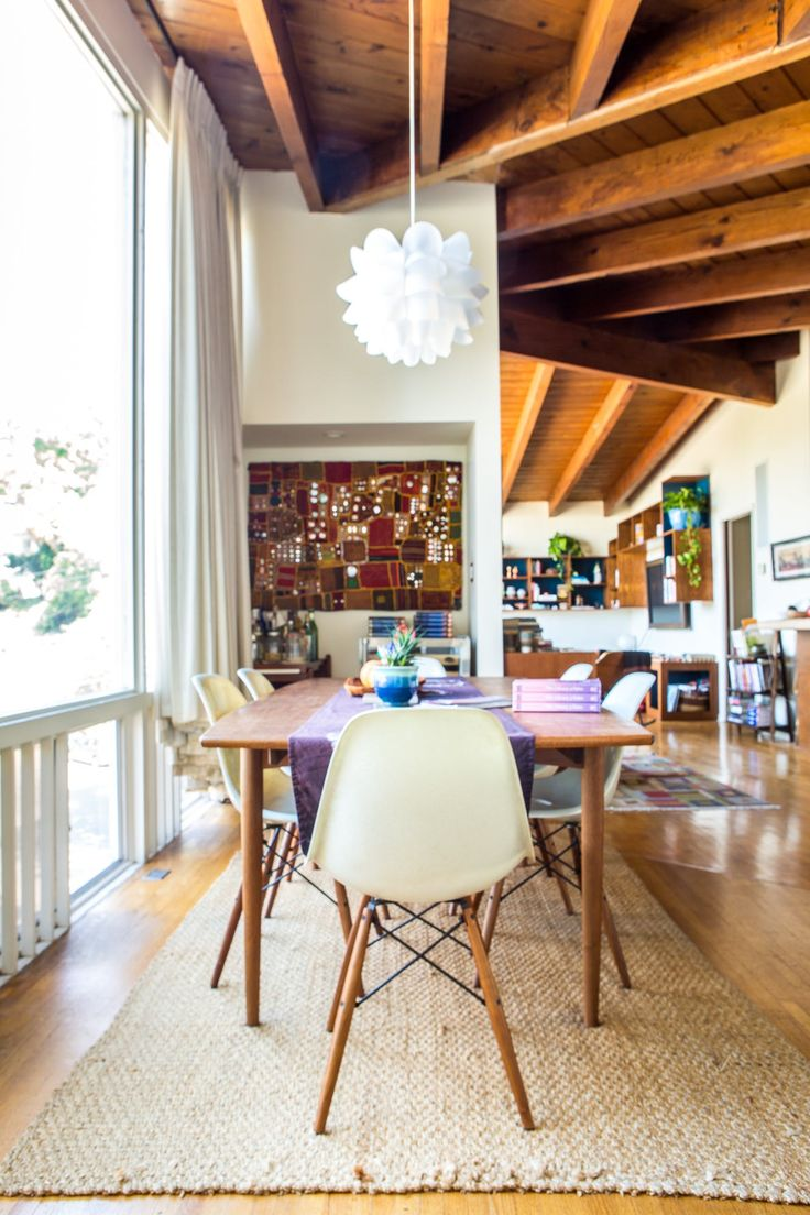 The teakwood dining table is from Danish Modern LA and the dining chairs are from Modernica. She found the jute rug on Overstock.