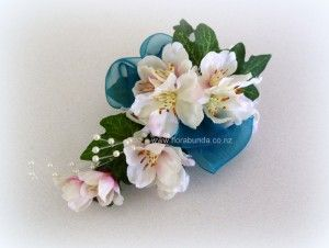Pink and Teal blossom corsage image
