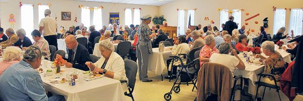 Participants at the W.W. Scott Senior Citizen Center in Marion were treated to a special ceremony and lunch Monday as the meals and activities room was renamed the Friendship Café.