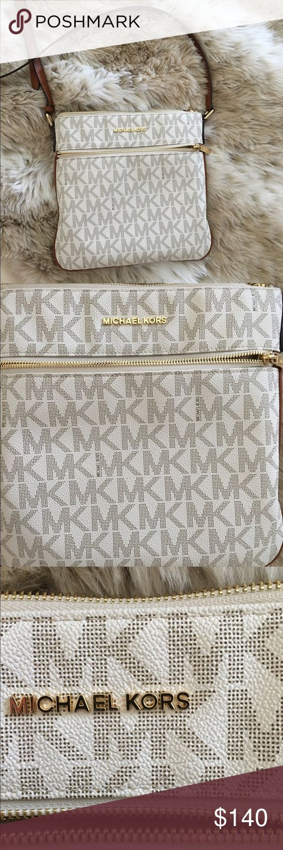 Michael Kors Cross Body Bag Authentic Michael Kors Bedford Logo bag, in perfect condition. Only used a few times. Sometimes a girl really needs the perfect bag to complement her spunky personality. That is just what the Michael Kors bag does! Perfect for an evening in or a day out. No matter where you take this bag it is sure to impress everyone around you. Michael Kors Bags Crossbody Bags