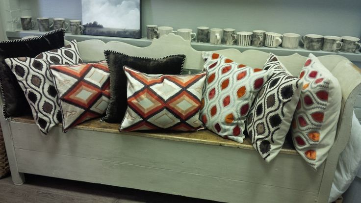 Colourful cushions on old bench
