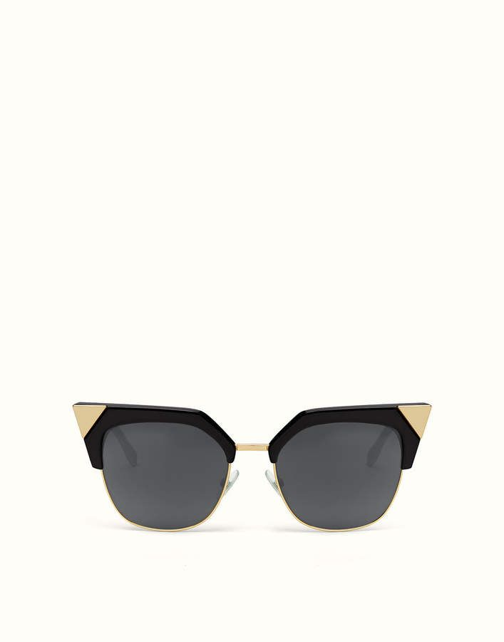 760fe787f0dd Fendi Iridia Iridia sunglasses with black optyl front that frames only the  upper part of the lenses, illuminated with gold metal triangles that  emphasize ...
