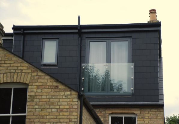exterior slate hung loft conversion with dormer and sheet glass juliet balcony