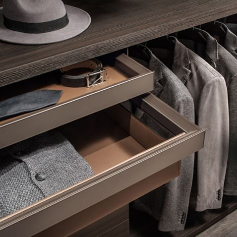 pull out shelf with tray and and small tray covered with regenerated castoro leather, brown aluminum structure and mat lacquered caffé glass fronts.