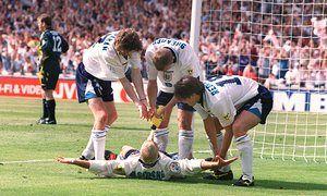 Alan Shearer, Steve McManaman and Jamie Redknapp help Paul Gascoigne celebrate his memorable goal against Scotland at Wembley during Euro 96.