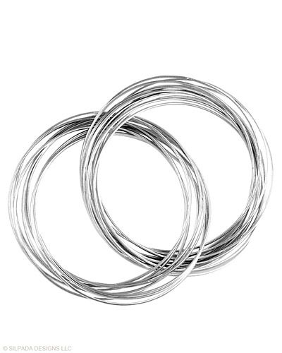 Finish any look with these twenty-one interlocking Sterling Silver Bangles.