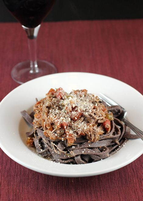 A glass of Syrah pairs with duck-Syrah ragu over Syrah-flour pasta.