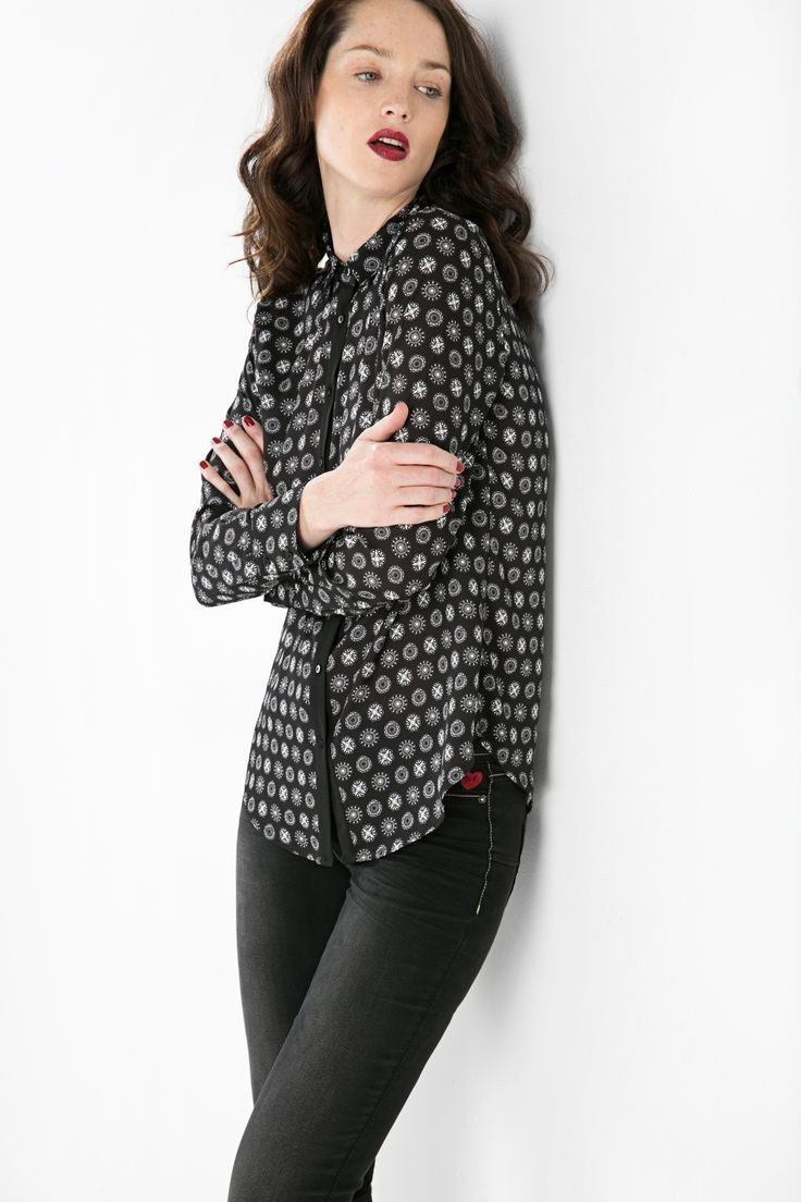 We're all about party-ready clothes this Fall, and this shirt fits our bill pretty nicely. This black micro-print top is designed for maximum fun, whether that be in the office, or beyond...