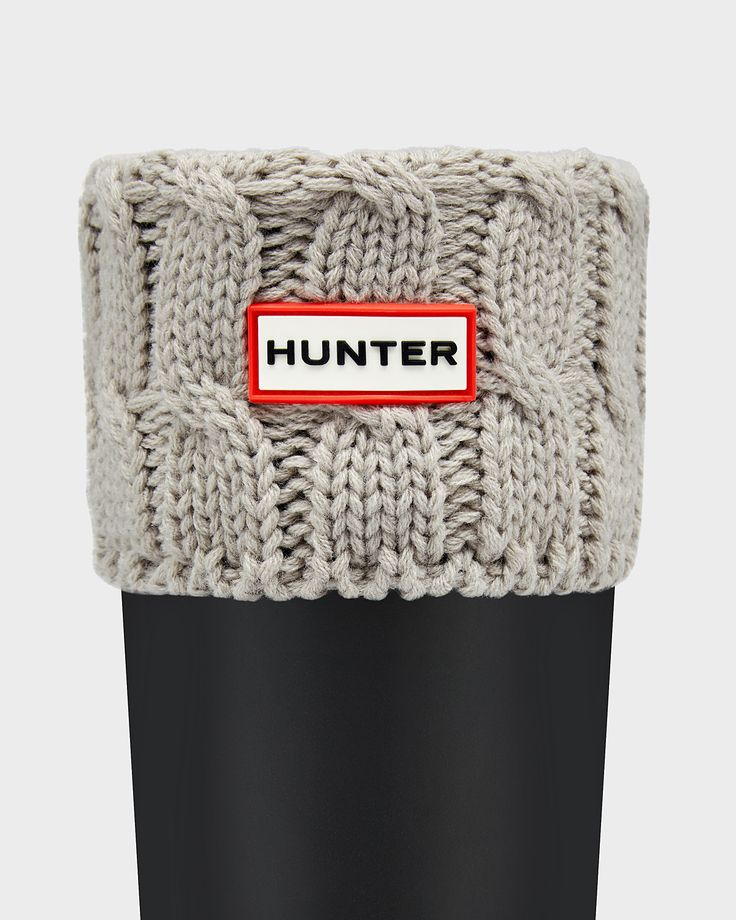 These boot socks are made from soft microfleece with a contrast six stitch cable knit cuff.