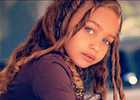 Beautiful mixed girl. Her hair is the most beautiful caramel/chocolate color!