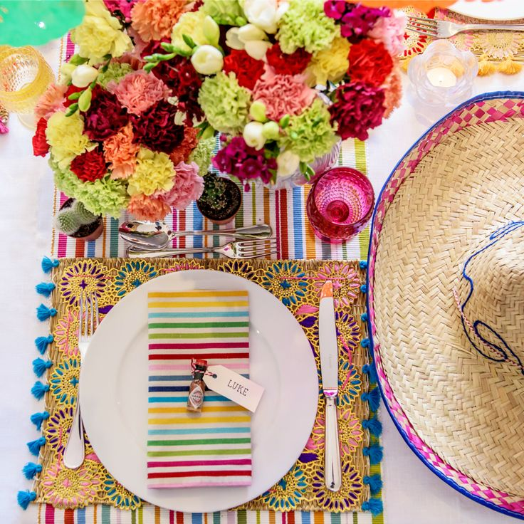 Be inspired to host your own Cinco de Mayo Party with this table setting inspiration by The Real Housewives of Sydney's Nicole O'Neil. Combining vibrant colour with fresh florals, mini cactus favors and sombreros, this fun Mexican Themed Fiesta Party would be perfect for birthdays, celebrations and casual get togethers with friends!