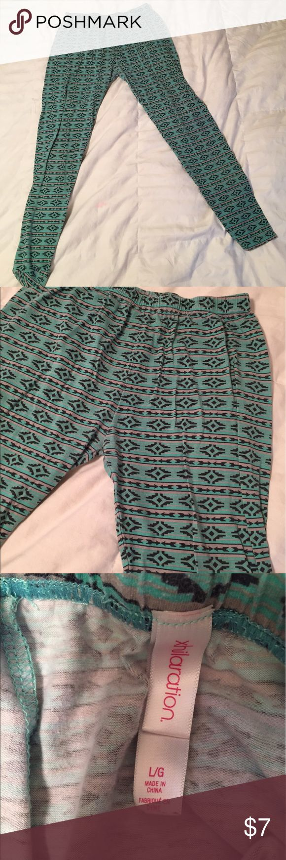 Tribal Print Leggings Black, teal, and grey tribal print cotton leggings. The lightweight material has a Skinny fit that covers the full leg. Great to pair with solid color ruining tops. Xhilaration Pants Leggings