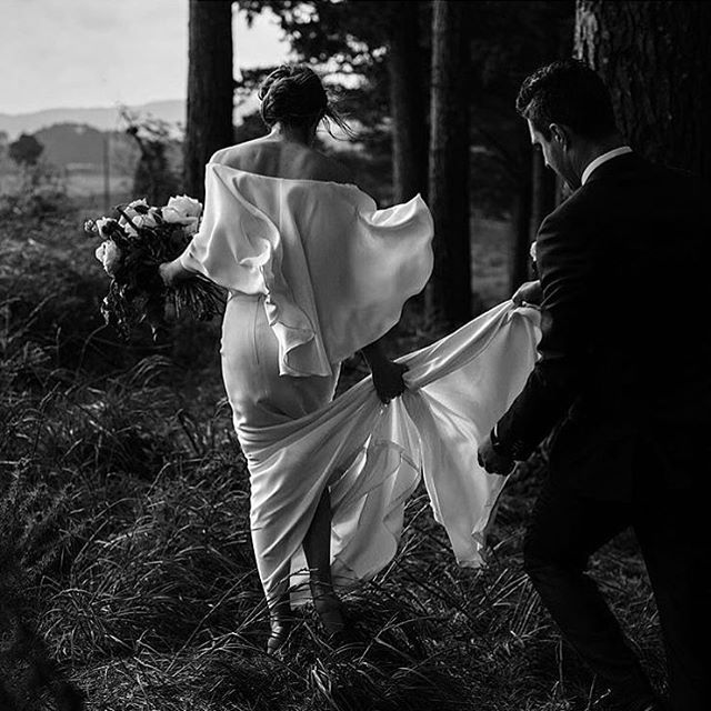 An outfit not typical of the traditional bridal gown.  Emma wears Parvia cape and Delfina skirt • image by @danellebohane