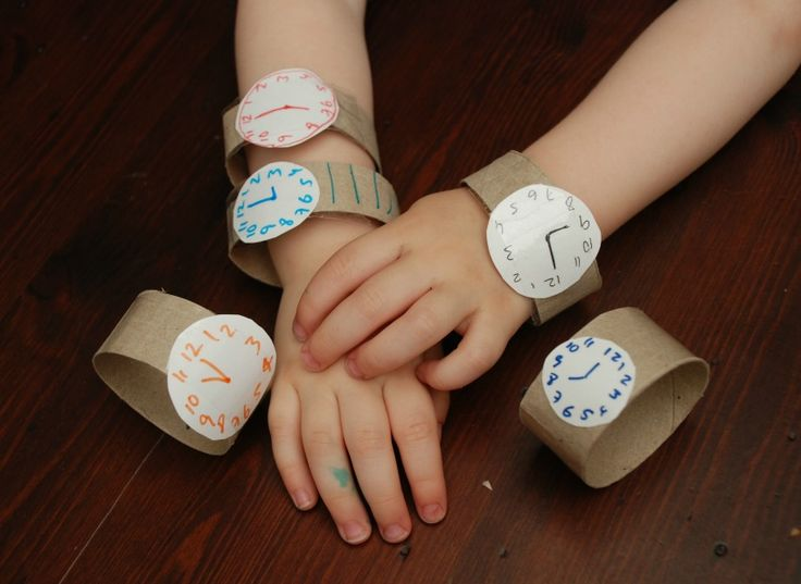 Easy Toddler Crafts using Toilet Paper Rolls | Toddler Times  I did this and the paper towel rolls *barely* slid over the 2.5 year old hands.  But super cute!  And I also google image searched watch faces and printed them.
