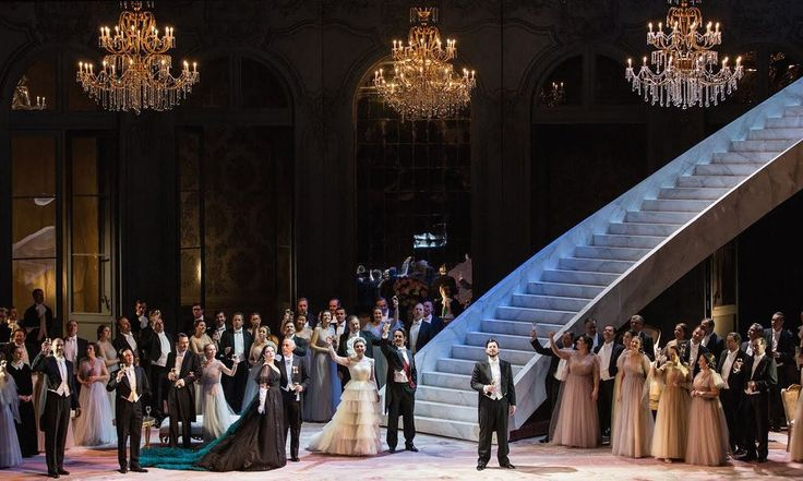 The director's take on Verdi's tragic opera has costumes by Valentino and sets by Batman's production designer … and still it is traditional and cliched
