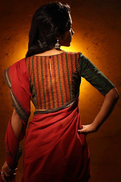 This Kalamkari - Ajrakh patchwork blouse is perfectly paired with a red, black or an off-white saree.