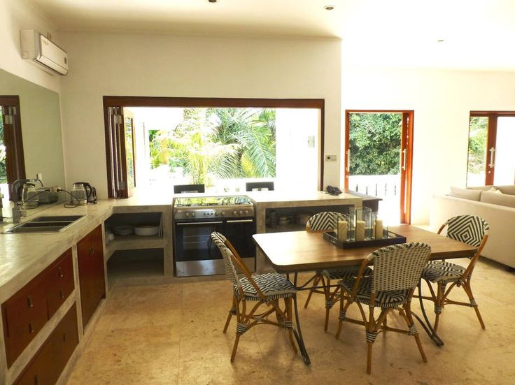 Apartment in Seminyak, Indonesia. A 2 Bedroom serviced apartment sited around a swimming pool and a huge banyan tree in Petitenget, Seminyak.  This airy apartment, set among lush gardens, is a 4-minute walk from Petitenget beach, and 2.3 km from the popular Seminyak dining and sho...