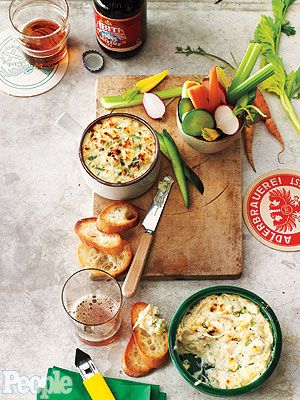 Ralph Brennan's Creole Crab Dip  • 3 shallots, peeled and sliced  • 5 tbsp. butter (divided)  • ½ cup heavy whipping cream  • 11 oz. cream cheese (softened and divided)  • 3 tbsp. Marscapone cheese  • ½ cup chopped green onion  • 2 dozen baguette slices  • Salt  • Freshly ground black pepper  • 1 lb. crab meat  • 2 oz. goat cheese (crumbled)