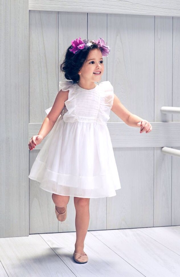 Nelly's new Mae Dress is truly beautiful! This exquisite dress is wonderful for any special occasion. Flutter sleeves and ruched bib add a traditional nod o...