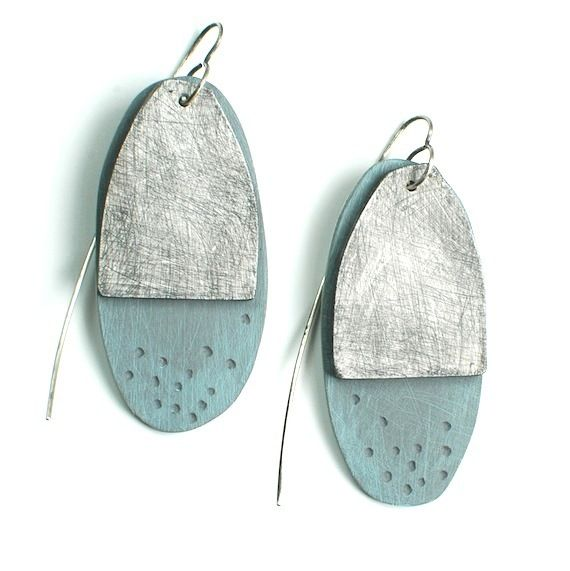 Genevieve Williamson: Iceberg Earrings. Two piece, lightweight polymer clay earrings move when you do. The front piece is heavily textured warm white and the back section is pale blue/grey. Each pair is hand cut, textured and finished. Ear wires are oxidized sterling silver.
