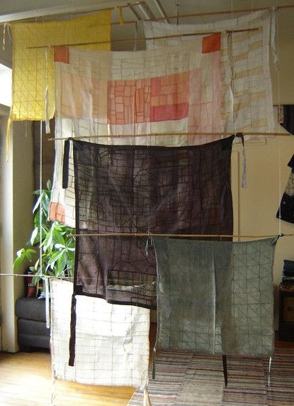 A cascade of Korean Pojagi (or the hand stitched wrapping cloths that were sewn…