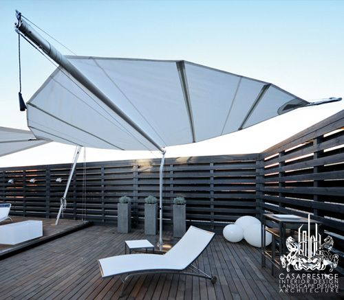 Ideal for large outdoor spaces, dining decks and poolside patios, these sail awnings have a trendy, nautical look we love. The Defense awning covers 11 or 14 m2, which mounts to a pedestal and rotates 90 or 360 degrees, depending on the model. The Intrepid is a self-standing shade, supported by four steel poles, eliminating the need for ground anchors.
