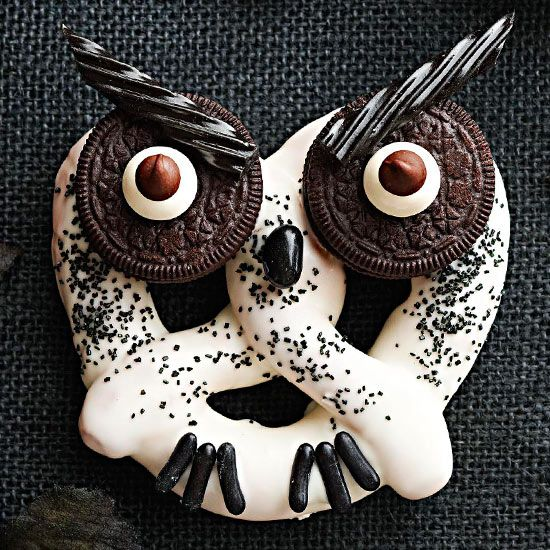 Haunted Hooting Owl Pretzels~T~ Cute. Large pretzels dipped in melted confectioner's coating. Sprinkled with black sanding sugar, black jelly bean nose, licorice candy talons, oreo eyes and licorice twist eyebrows.