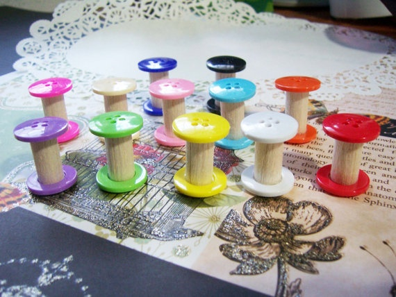 Spools made from dowels & buttons.