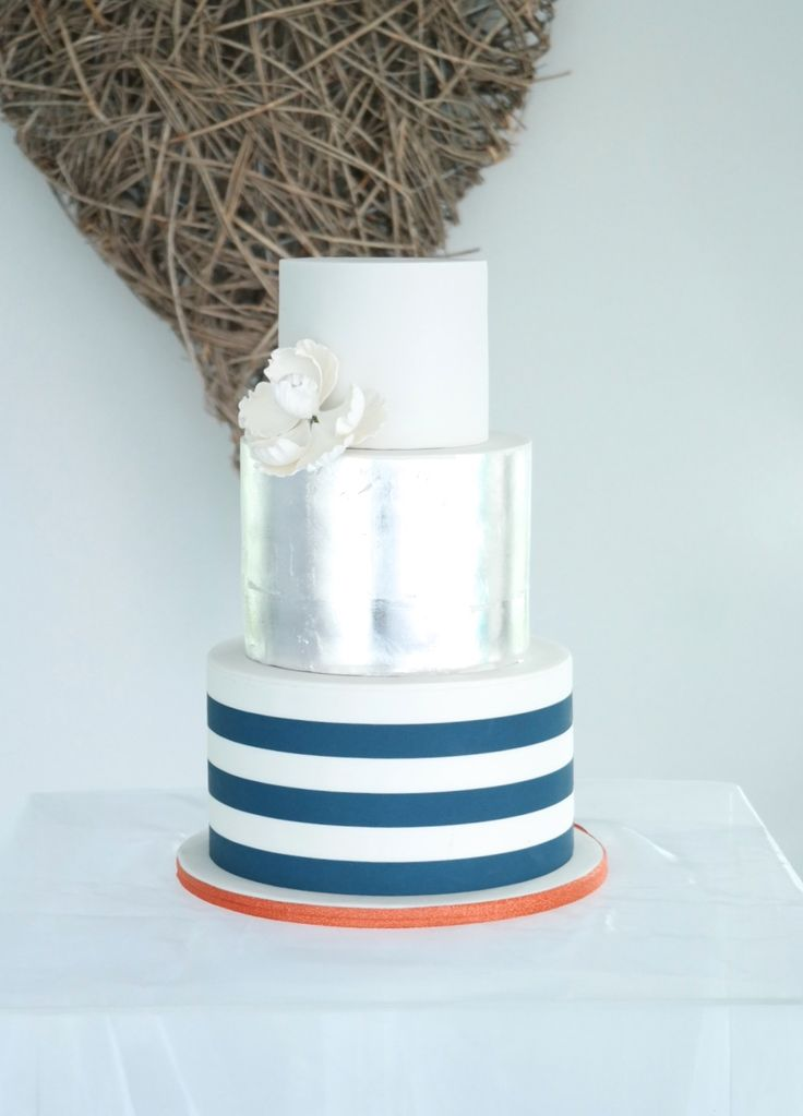 Silver leaf, orange, navy, wedding cake, stripes.