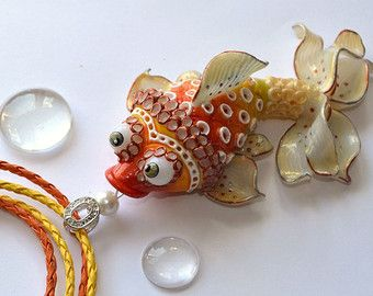 Polymer clay pendant with turquoise fish marine by Polyclaydesign
