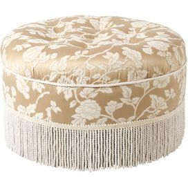 "Tufted ottoman with fringed trim and an off-white floral motif.  Product: OttomanConstruction Material:  Polyester and cottonColor: Champagne and off-whiteDimensions: 14"" H x 24"" DiameterJennifer Taylors, Floral Motif, Living Room, Sumner Ottoman, Focal Point, Wool Rugs, Fringes Trim, Chic Design, Tufted Ottoman"