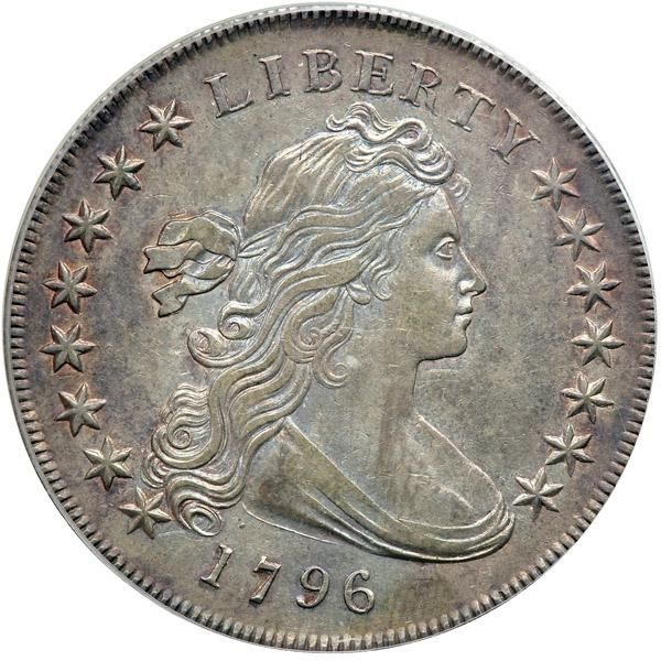 1796 B-4, BB-61 Small Date Large Letters Rarity 3. PCGS AU55 Subset of PCGS # 6860. In a new secure plus holder. Delicate surfaces are untouched by spotting or marks on this intensely pleasing Draped Bust, Small Eagle dollar, the light to medium gray toning graces satiny and dynamic surfaces. Since our observation is that this date is often well struck, then this sharp coin has every suggestion of precision manufacture as seen in hair curls, the drapery folds, as well as the plumage on the…